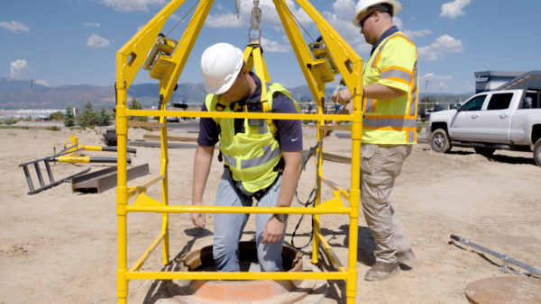 Two workers rehearse a confined space rescue using the Pelsue LifeGuard